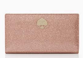 Kate Spade Glitter Bug wallet, $98. Available at katespade.com.