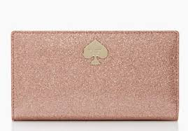 Kate Spade Glitter Bug wallet, $98. Available at katespade.com.