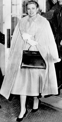 The ever classy Princess Grace Kelly carrying her famous Kelly bag.